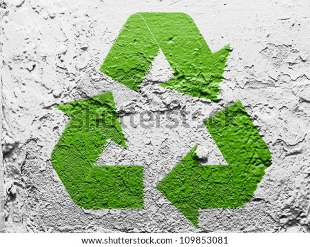Recycle symbol painted on grunge wall - stock photo