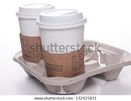 Recycle takeout coffee cups and tray isolated - stock photo