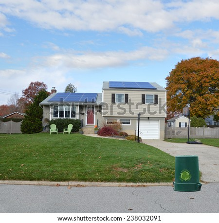 Recycle trash container curb side Suburban high ranch house autumn day residential neighborhood blue sky clouds USA - stock photo