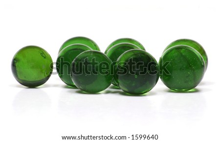 Recycled Glass Marbles on White Background - stock photo