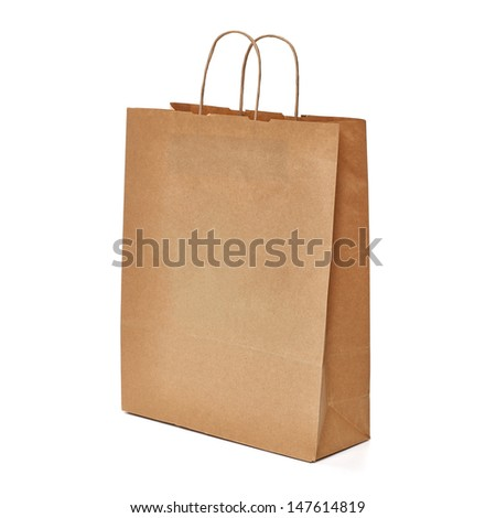 Recycled kraft brown paper shopping bag on white background - stock photo