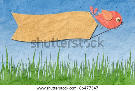 recycled paper craft ,Bird with blank Label on the blue sky - stock photo
