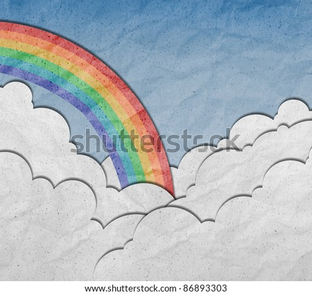 recycled paper craft ,Blue sky with  cloud and rainbow - stock photo