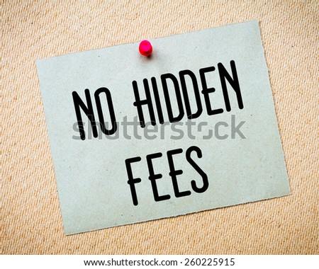 Recycled paper note pinned on cork board. No Hidden Fees Message. Concept Image - stock photo