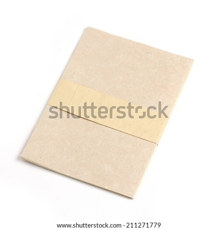 Recycled paper notebook front cover, isolated on white background - stock photo