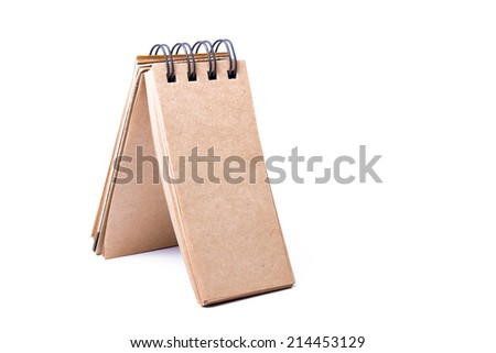 recycled paper notebook in vertical - stock photo