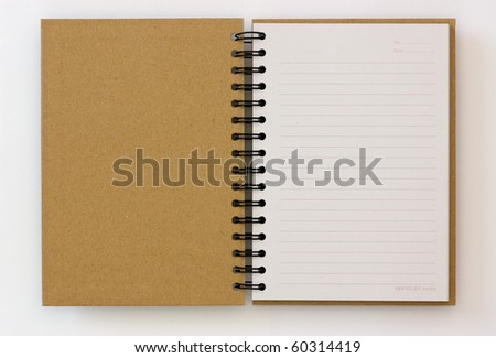 recycled paper opened notebook on white background