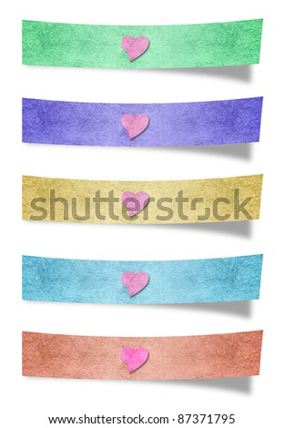 recycled paper stick and love symbol on white background - stock photo