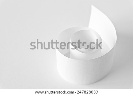 recycled white paper spiral against a white background