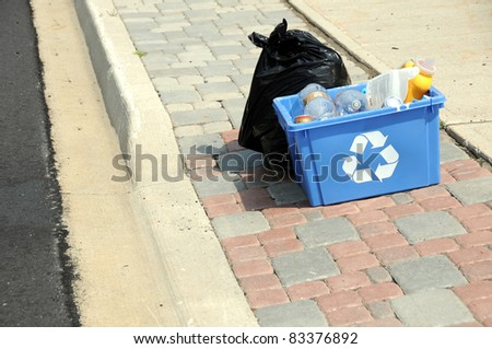 Recycling and garbage on road for pick up - stock photo