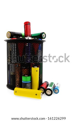 Recycling and renewable energy sources, aa different batteries in basket - stock photo