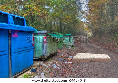 Recycling bins and rubbish in country lane - stock photo