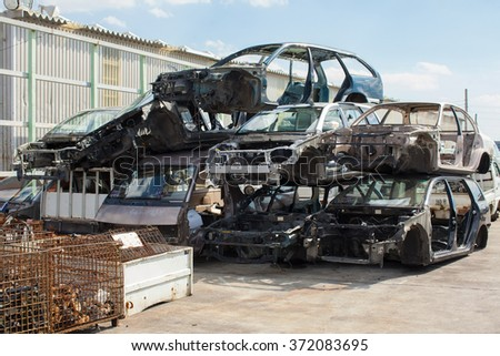 Recycling cars. Scrap metal from cars - stock photo