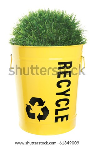 Recycling concept. Green grass growing out of recycle bin, showing the recycle sign / icon. Yellow recycling bucket isolated on white. - stock photo