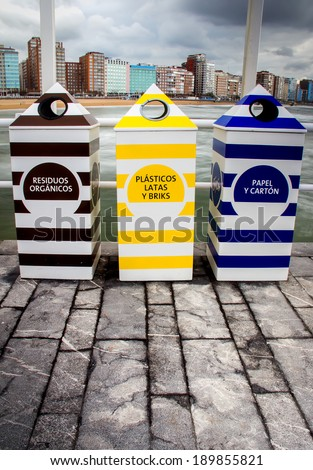 Recycling containers on Gijon beach - stock photo