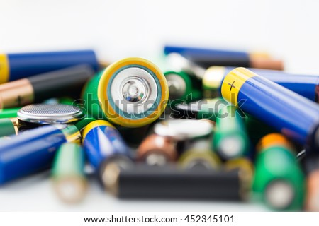 recycling, energy, power, environment and ecology concept - close up of alkaline batteries heap - stock photo