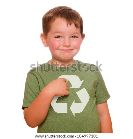 Recycling for the future concept with smiling child proudly pointing at recycling logo on his green t-shirt - stock photo