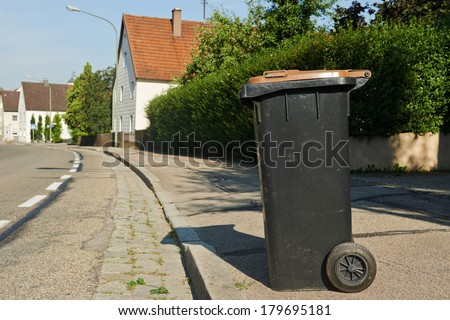 recycling garbage bin standing on urban street - stock photo