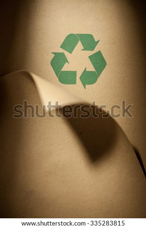 Recycling logo on recycled paper.
