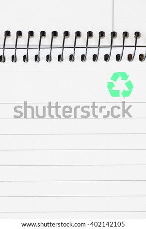 Recycling symbol on empty white paper in notepad. Concept of eco awareness, supply reuse and green thinking. - stock photo
