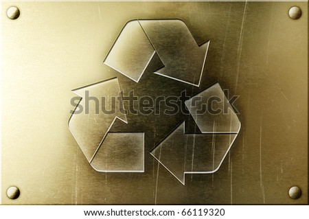 Recycling symbol on shiny yellow brass metal plate