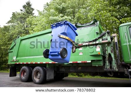 Recycling truck picking up bin - Horizontal - stock photo