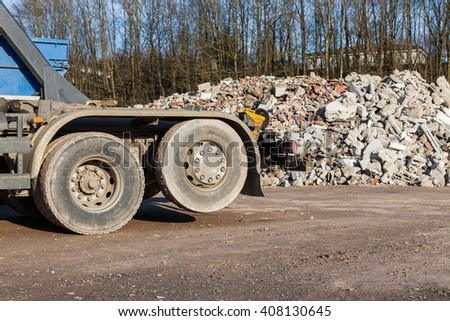 Recycling trucks with rubble in the background - stock photo