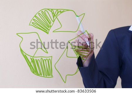 Recycling. Woman drawing recycle sign - stock photo