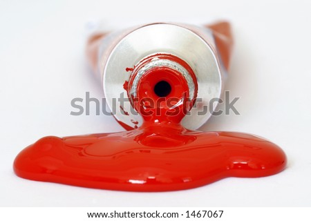 Red acrylic paint pouring from a tube. Colour can be easily changed to any colour using hue/saturation in photo package