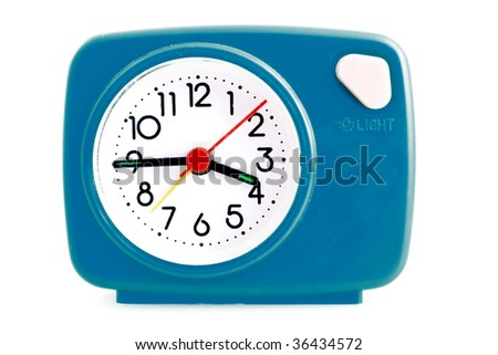 Red alarm clock on a white background - stock photo