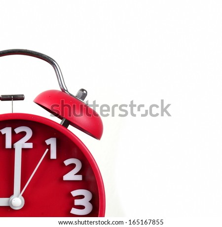 red alarm clock, showing time - stock photo