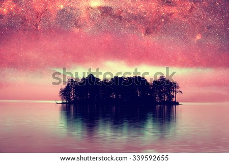 red alien landscape with alone island over the night sky with many stars - elements of this image are furnished by NASA - stock photo