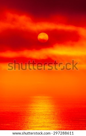 red alien sunset over an ocean - stock photo