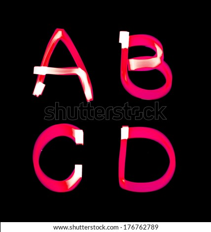 red alphabet created with light (A, B, C, D) - stock photo