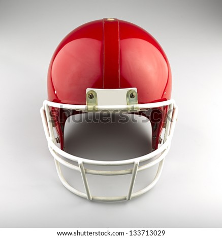 Red American football helmet - stock photo