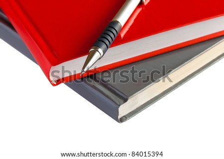 Red and black books and a pencil on the table isolated on white background - stock photo