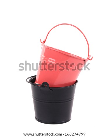 Red and black bucket in stack. Isolated on a white background.