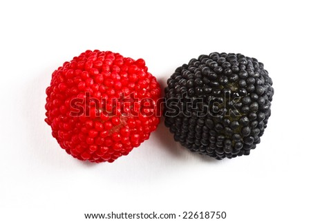red and black candies on white background - stock photo