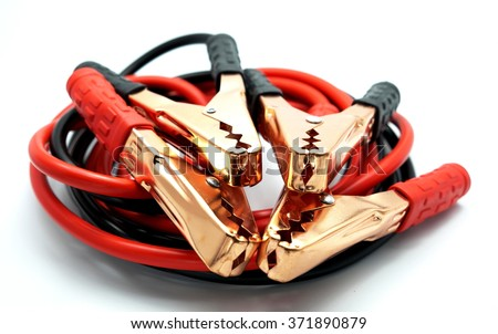Red and black car battery bumper cable, isolated on white background. Focus on metal. - stock photo
