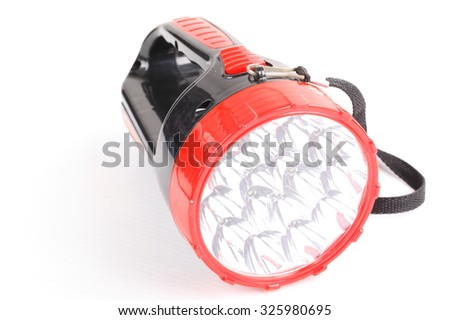 Red and black flashlight isolated on white