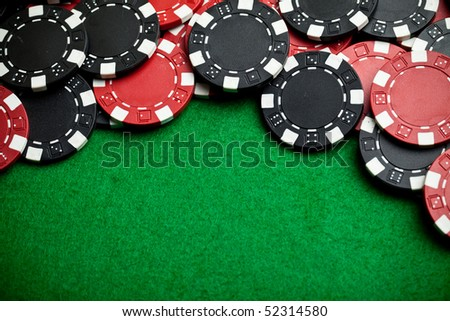 Red and black gambling chips - stock photo