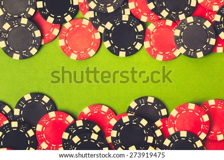 Red and black gambling chips. vintage background