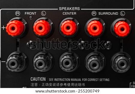 red and black speaker connectors of AV receiver - stock photo
