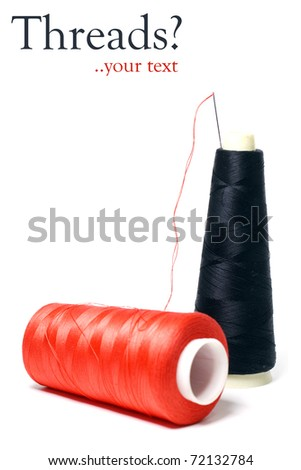 Red and black spools with cotton threads, isolated on white background