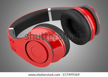 red and black wireless headphones isolated on gray background - stock photo