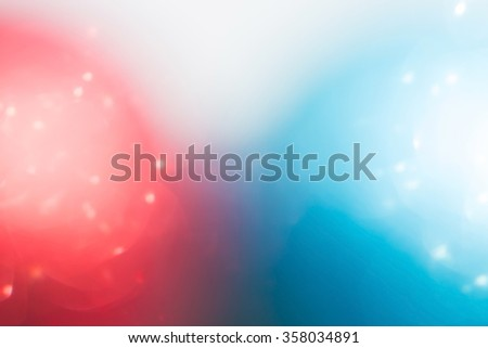 red and blue background, abstract bokeh light celebration blur background - stock photo
