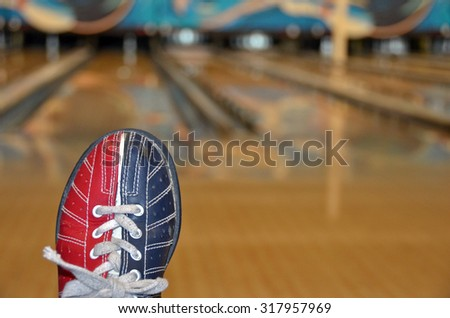 red and blue bowling shoe in bowling alley - stock photo