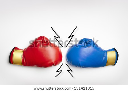 Red and blue boxing gloves on white background - stock photo