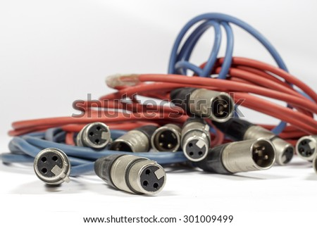 Red and blue cables with XLR connectors - stock photo