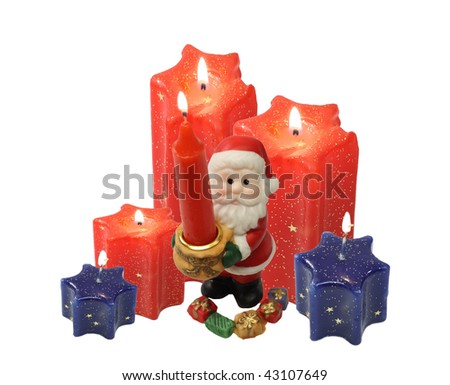 red and blue candle  burn and light on white background.  Santa Claus stay with burn candle.